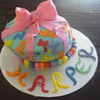 Fingerpaint Whimsical Cake  Made from two 8 inch and a 6 inch round. French vanilla cake, cookies and cream filling, vanilla bc, covered in fondant, handcut...