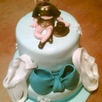Jennifer Is 18  small 2 tier vanilla cake with Blueberry & Cream filling, iced in BC, then covered in Fondant. Bow, Ballet Slippers and Figure made...