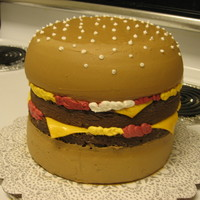 Double Cheeseburger All chocolate cake. Buttercream frosting, added some cocoa powder to achieve bun color. Fondant cheese. Made this for my 6 year old who is...