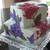 Lilac Birthday/mother's Day Cake Chocolate cake w/raspberry filling, MMF, buttercream fondant flowers.