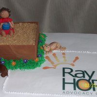 Girl In Sand Box-Donation Cake Edible image logo, fondant sand box, girl figure, cat, dog, lady bug and flowers
