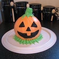 "Jack-O-Lantern Cake Practice cake for Cub Scout Halloween party. 3 layers vanilla cake, & buttercream frosting. I used a Wilton 6 "" pan for the middle..."