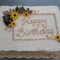 Multi Bday   mATCHING CAKE JUST POSTED ALSO. leaves are chocoalte flowers are fondant.