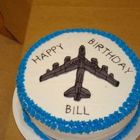 B52 Birthday Cake Chocolate Cake, White BC Icing, and that is supposed to be a B52 Bomber on top