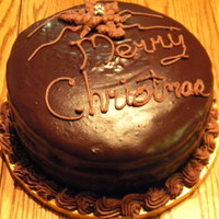 Christmas 2009 Ganache Cake Four layer chocolate cake, white chocolate filling, semisweet ganache coated. I chilled the remaining ganache and mixed it into bc to pipe...