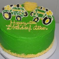 Allen's John Deere Cake Yellow cake dyed to be green and yellow layers. BC icing, Hay bales are yellow cake w/ BC. Tractors are free hand from reference chocolate...