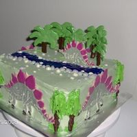 Stegosaurus Birthday Cake Entire cake is edible! Trees, Stegs, and Rocks are all chocolate! 8x8 square cake. Buttercream icing