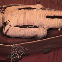 Mummys Coffin Made for DH's work. Modeling chocolate box, fondant covered mummy cake and sugar veil webs