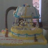 Carousel Cake   Second view of carousel cake. I made the cake with strawberry mousse and fresh strawberry.