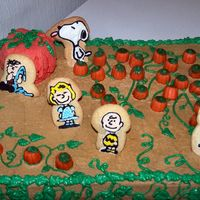 "Charlie Brown And The Great Pumpkin 11""x15"" yellow butter cake, w/ crusting BC - ""Peanuts"" figures are made out of royal icing, and are attached to sugar..."