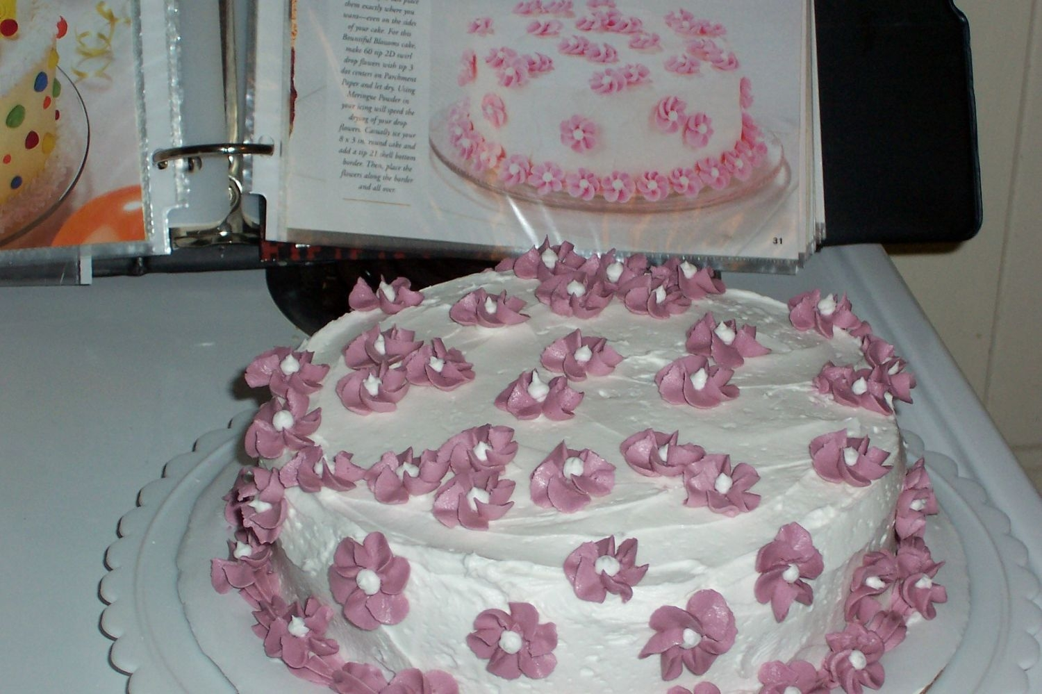Course I Cake  I made these swirl flowers (with buttercream) on parchment paper and then placed them on the cake. I brought this to our family Easter...