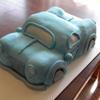 Blue Car Cake Made for a friend's son's 2nd birthday. Homemade MM fondant. Due to laziness I used a pearl dust for the in windows and mirrors...
