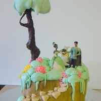 Princess & The Frog This one was for a friend's 2 yr old daughter. The tree is a dowel wrapped with wire for the branches, covered in rice crispy treats...