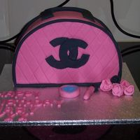 Chanel Makeup Bag Chocolate mud cake with fondant. Roses and make up also made using fondant.
