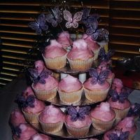Butterflies & Fairy Floss   I made this for my nieces christening. Vanilla cupcakes with buttercream frosting and fairy floss.