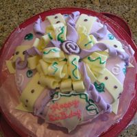 Birthday This is my first time using fondant. I made a traditional white cake with a thick frosting filling. ON THe outside I spread homemade...