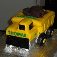 Dump Truck Cake Chocolate WASC with buttercream icing, covered in fondant. My first using an airbrush on fondant, love it!