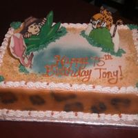 Safari Cake chocolate cake with buttercream, chocolate transfer animals, airbrushed leopard print on sides