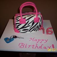 16Th Birthday Zebra Print Purse Cake This is the cake I made for my daughter's 16th birthday this year. It's iced in buttercream with fondant accents. 2nd time making...
