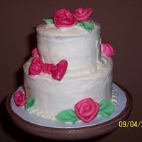 Petite Rose Cake This is a small stacked cake (6 and 4 inch) I made for my grandmother's birthday. First time making fondant ribbon roses and leaves,...