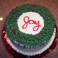 Christmas Wreath Cake Eggnog flavored cake I made for my Sunday School Christmas party. It's iced in mashmallow creme butter cream icing and the sparkly...