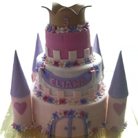 Pink And Purple Castle bottom tier is carrot cake with white chocolate cream cheese frosting, top two are chocolate fudge cake with chocolate fudge frosting, all...
