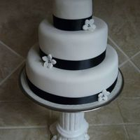 "Black & White Wedding Cake This was a mini practice cake I made. The bottom tier is only 6""."
