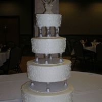 My First Paid Wedding Cake this was my first paid wedding cake. I did it for a longtime friend...and learned alot of lessons for the next one. This picture was taken...