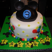 Mickey Mouse Ears Fondant covered cake and board with a gumpaste hat and ears. Thank you to all the people on here that helped me with the hat and ears! I...