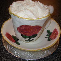 Cup Of Frothy Latte! I made the saucer and teacup by hand out of gumpaste and painted the flowers on it. The cup is full of cake and this serves as a single...