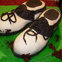 Golf Shoes These shoes don't smell at all like my husband's real ones do! Cake inside, fondant covered and fondant decorations.