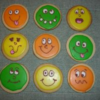 Silly Face Cookies Practicing with Toba Garrett's Glaze Icing. It was a bit too thin...but so much fun to work with and I love the way it dries hard on...