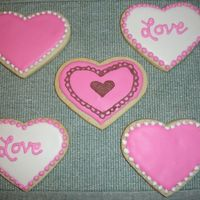 Heart Cookies Practicing with Antonia's Royal Cookie Icing. This is a dream to work with...but it dries VERY hard and crunchy.