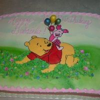 Winnie The Pooh First Birthday   Winnie and Piglet are FBCT on a white half sheet iced in BC. Piglet's holding gp balloons, gp drop flowers.
