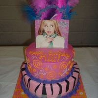 Hannah Montana  white cake with BC and fondant accents. The topper is a gift bag I picked up at WM and used feathers to add drama (Note to self and others...