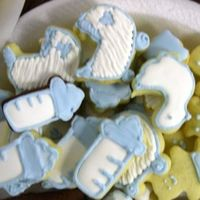 Shower Cookies Shower cookies for a coworker who is having a baby boy. Cookies are NFSC with royal icing. The chocolate ones are NFSC with dutch cocoa...