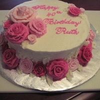 Feminine Birthday This is a white chocolate raspberry torted cake with raspberry filling. BC frosting, BC roses. Combination of ribbon and traditional roses...