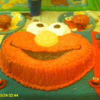 Elmo B-Day Cake Almond and vanilla cake, top cover with BC and vase cover with Satin Fondant