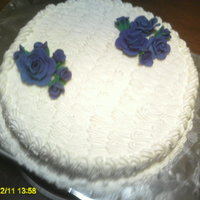 Simple B-Say Cake Satin ice flowers, bc frosting on a almond cake