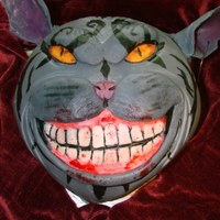 American Mcgee's Cheshire Cat A friend of mine wanted to surprise his girlfriend with this cake. She is a huge fan of American Mcgee. It was really fun to make.