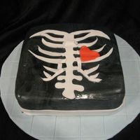 Spooky Skeleton Cake This cake was inspired by the spirit of halloween. It was a vanilla carmel cake covered in fondant!! I had a great time making it!!!