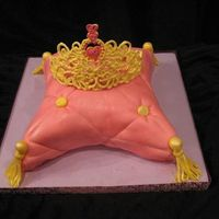 Pretty Princess Pillow Cake This cake was made as a suprise for a birthday. The girl absolutely loved it so that was good. It was made using MMF and buttercream. The...