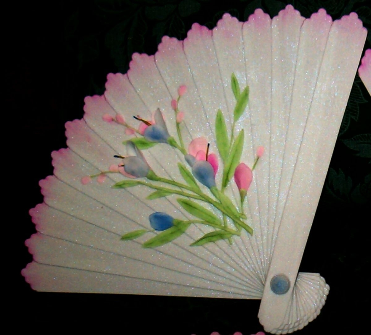 Pink White Fan With 2D Flowers This fan was made to go on top of a cake for the OSSAS when the theme was wall paper. It was a toughy. The humidity was so high that by the...