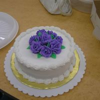 Final Cake Of Wilton Course 1  Chocolate cake with raspberry filling. Butter cream icing the roses from heck- took me about 10 straight hours of non-stop practice to...