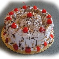 "Fudge Sundae Cake   8"" chocolate cake with whipped topping filling and icing, melted chocolate drizzles, crushed nuts and cherries. MMMMM!"