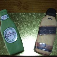 "Happy Hour! Heineken And Black Label This set of cakes was taken to a pub. They're both in fondant and it doesn't show, but they're 3"" high. Both serve..."