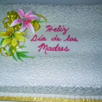 Grandma's Cake Every year my grandma wants a bigger cake! The flowers are store bought. The cornelli lace is done with a #3 tip.