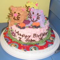 Kitties In A Basket Buttercream cake with royal icing flowers. Flowers don't really match because I was in a hurry and just used whatever I had in stock....