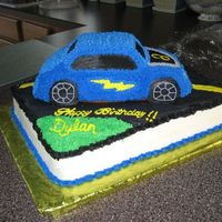 Hot Wheels Cake Base is a 1/2 sheet chocolate cake with buttercream filling and the car is white. All decorating is done in buttercream icing. A special...