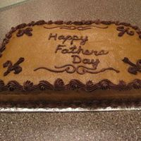 Father's Day  My dad is a simple man, so I attempted a simple cake. Not my favorite but it sure tasted good!! Milky Way swirl cake with buttercream icing...